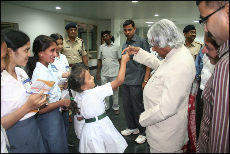 Kalam playing with a child