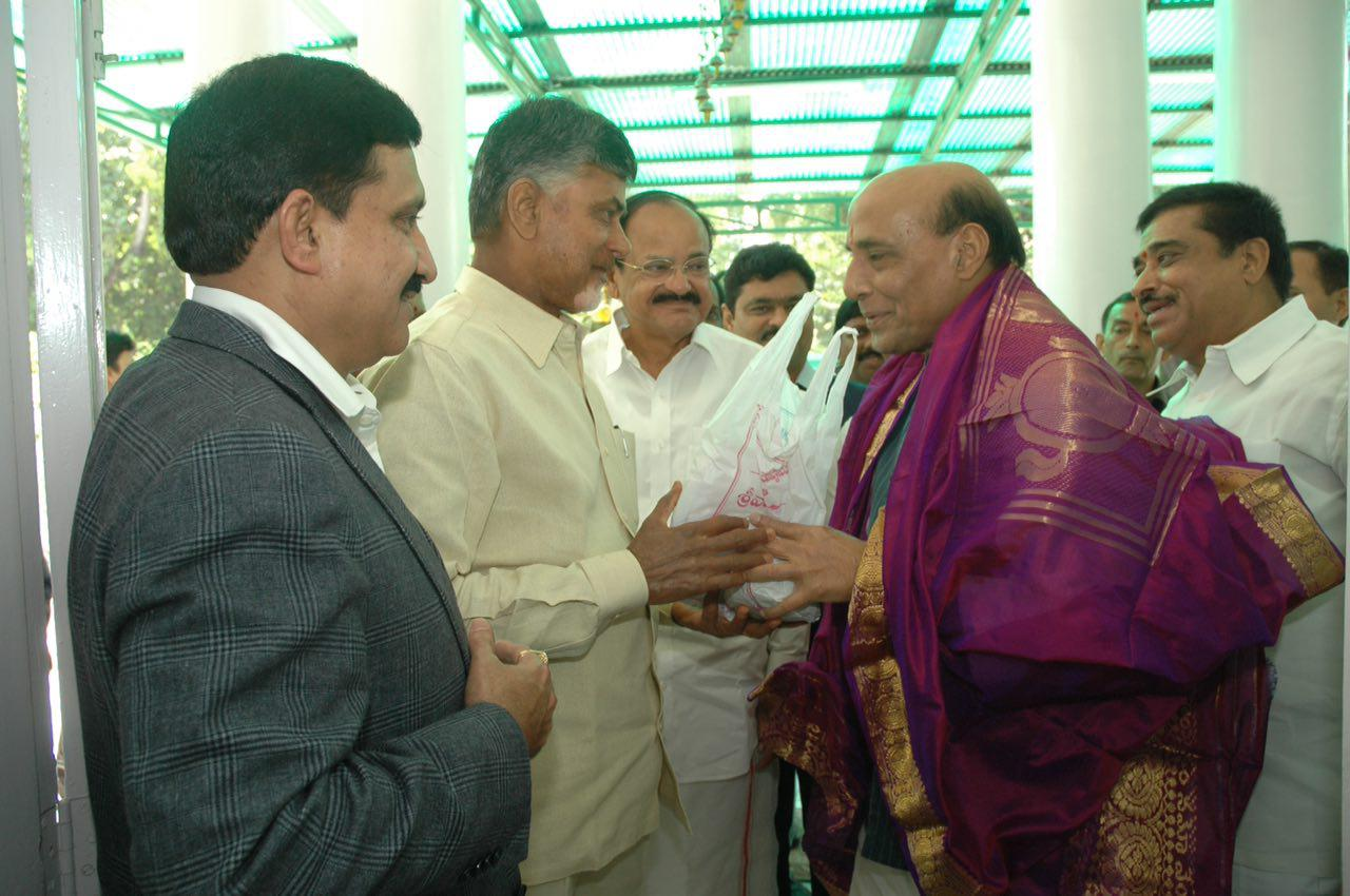 Naidu presenting shawl and Tirupati Laddu to union home minister Rajnath Singh