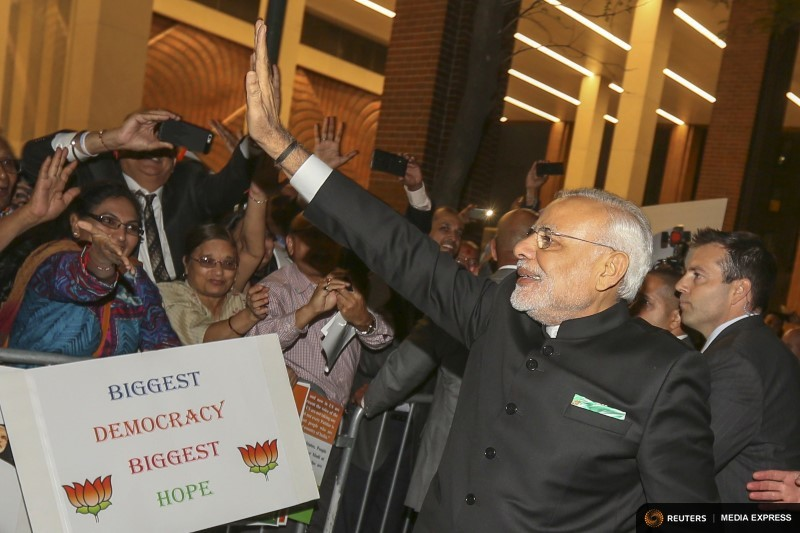 India's Prime Minister Narendra Modi waves to well wishers after arriving at his hotel ahead of the 2015 General Assembly of the United Nations in Manhattan, New York
