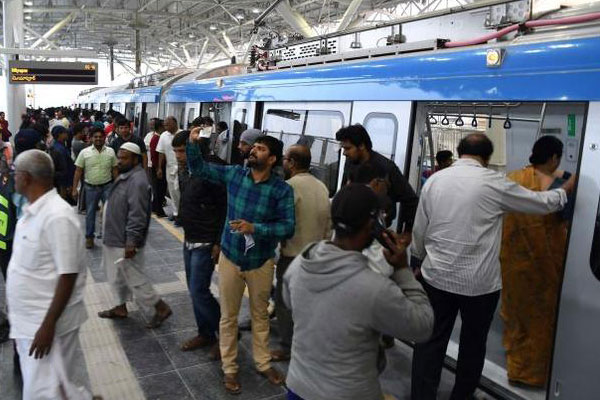 Visitors to Hyderabad have a brand new attraction now. That's Metro! For thousands of people coming to Hyderabad for various purposes, Metro has moved into their itinerary. Besides, a joyride on Metro for families on weekends is 'in' thing if the rush witnessed on Saturday and Sunday last was any indication. Barely a week after its inauguration by Prime Minister Modi, the new mode of mass transport has been gaining momentum with every passing day. Metro trains started operating on a 30km stretch of the first phase of the project from November 29 and in one week the elevated mass transport has registered a footfall of more than a million. The highest recorded so far was on Sunday when 2.4 lakh people travelled on different routes. The numbers are music to the ears of concessionaire L&T and the Telangana government as both of them are partners in the mega venture. With commuter numbers steadily increasing, the government is mulling revival of an old plan to extend Metro to Shamshabad airport. If it is done, air passengers could zap in and out of the international airport which itself is witnessing a phenomenal increase in passenger traffic. There are, of course, initial problems which are continuing. Major passenger complaints include no drinking water facility, lack of platform signs and display boards. There are safety concerns too, a major one being passengers trying to travel on footboards or standing near the doors, without realising the fact that they are automated. Looks old habits die hard. Nevertheless, Metro authorities are showing remarkable patience in dealing with situations that are peculiar to Hyderabad.