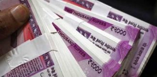 Rupee slips to a new low; touches 71.79/$
