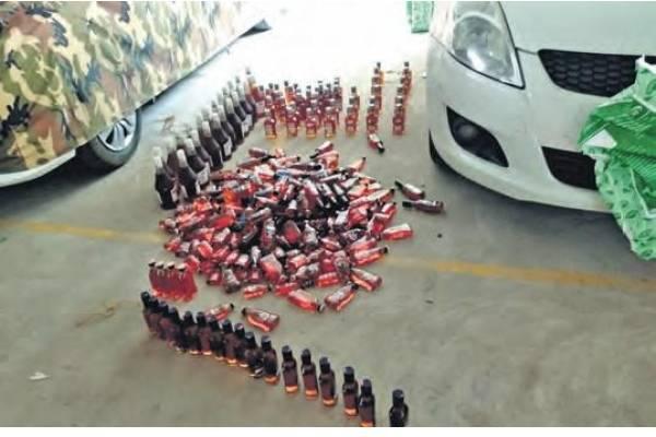Durga Temple Board Member resigns Liquor smuggling