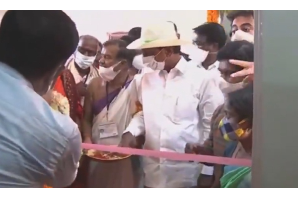 With scissors not available, KCR pulls off ribbon